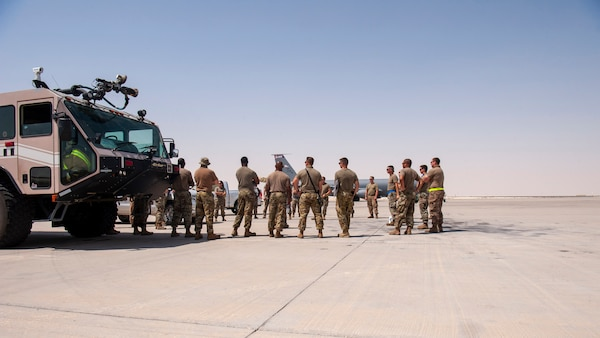 Members of the 379th Air Expeditionary Wing huddle before a KC-135 Stratotanker aircraft hot refueling training scenario for certification at Al Udeid Air Base, Qatar, Sept. 21, 2020. The training, the first for a KC-135, will enhance refueling mission capabilities and cut the refueling time in half.