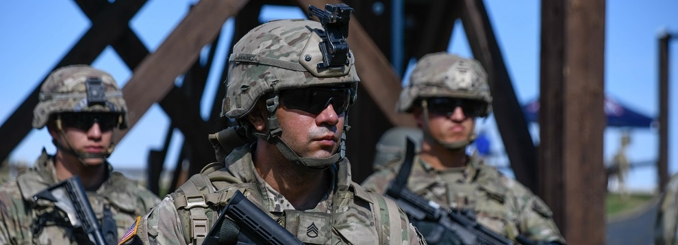U.S. Staff Sgt. Juan Sanchez, 18th Military Police Brigade, takes directions from the range safety during the M4 Carbine zeroing range portion of the U.S. Army Europe European Best Warrior Competition at U.S. Army Garrison Hohenfels Training Area, Germany, July 27, 2020. The competition is an annual event with competitors assigned to United States Army Europe and United States Army Africa. Officers, noncommissioned officers and junior enlisted Soldiers compete in separate categories and are evaluated on general military knowledge, physical fitness and common military tasks. Winners in the NCO and junior enlisted categories will advance to represent U.S. Army Europe at the Army Best Warrior Competition at Fort Lee, Virginia. For more information about the competition, visit https://www.eur.army.mil/EBWC/. (U.S. Army photo by Spc. Denice Lopez)