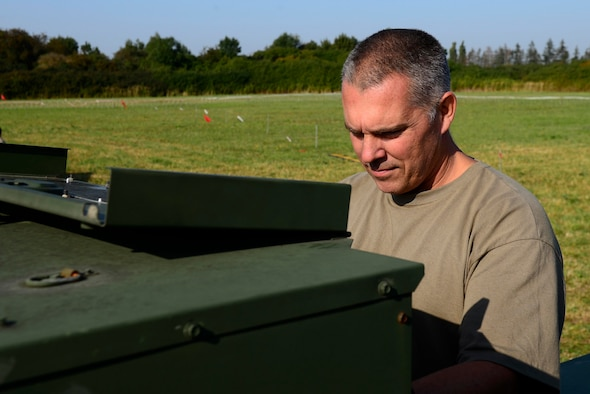 U.S. Air National Guard Master Sgt. Jared Hass, 116th Air Control Squadron heating, ventilation, and air conditioning noncommissioned officer in charge, checks a generator during exercise Astral Knight 20 at Malbork Air Base, Poland, Sept. 23, 2020. Members of both the 116th and 128th ACS augmented the 606th ACS during AK20. (U.S. Air Force photo by Tech. Sgt. Tory Cusimano)