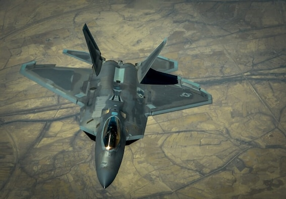 An F-22 Raptor is shown during a mission in support of Operation INHERENT RESOLVE. Yu Long attempted to fly to China while in possession of export-controlled and proprietary documents related to this aircraft and the F-35 Lightning II. (U.S. Air Force photo)