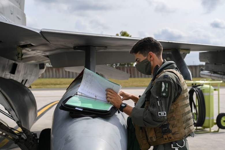 U.S. Air Force Capt. Timothy Joubert, 555th Fighter Squadron chief of mobility, performs a pre-flight check at Aviano Air Base, Italy, Sept. 24, 2020. Airmen and U.S. Air Force F-16 Fighting Falcons assigned to the 555th FS participated in exercise Brave Warrior 20 alongside Hungarian, Slovakian, and Romanian partners. During the exercise 555th FS aircraft will perform close air support with Hungarian, Slovakian, and Romanian coalition ground forces and receive fueling from Hungarian Defense Force logistics personnel at Papa Air Base, Hungary. (U.S. Air Force photo by Staff Sgt. Savannah L. Waters)