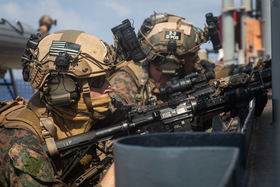 U.S. Marines provide security during a simulated visit, board, search, and seizure mission aboard dock landing ship USS Germantown (LSD 42), Sept. 6.