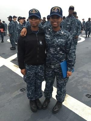 Quartermaster 3rd Class Malaysia McKnight and Fire Controlman 3rd Class Qunisha Lytch pose for a photo.