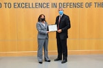DIA's Office of Security Director Jeanette Courtney (left) received the full operating capability certificate from the National Insider Threat Task Force Director Charlie Margiotta in a small ceremony last week at DIA Headquarters. (Photos by Ally Rogers, DIA Public Affairs)