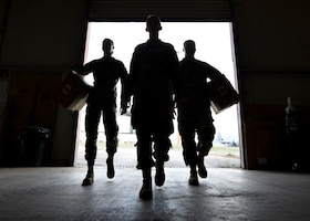 The 435th Air Expeditionary Wing surgeon general office Airmen walk into a warehouse at Ramstein Air Base, Germany, Sept. 22, 2020. The surgeon general office has oversight of all medical operations conducted for the 435th AEW throughout Africa and is the main resource for medical personnel regarding supplies, maintenance and readiness.  (U.S. Air Force photo by Senior Airman Madeline Herzog)