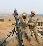 Soldiers of 1st Battalion, 65th Infantry Regiment, conduct mortar live-fire training on Aug. 20, 2020, at Camp Roberts, California. The 1-65th attended annual training with the 79th Infantry Brigade Combat Team for the first time from Aug. 13- 28, 2020, since becoming aligned under the brigade in 2018.