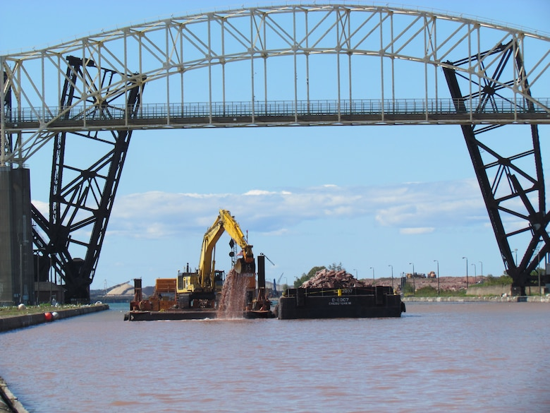 Trade West Construction continues the deepening of the Upstream Channel for the New Lock at the Soo in Sault Ste. Marie, Michigan. Deepening is the first phase of the new lock project and will be completed in the fall 2021.