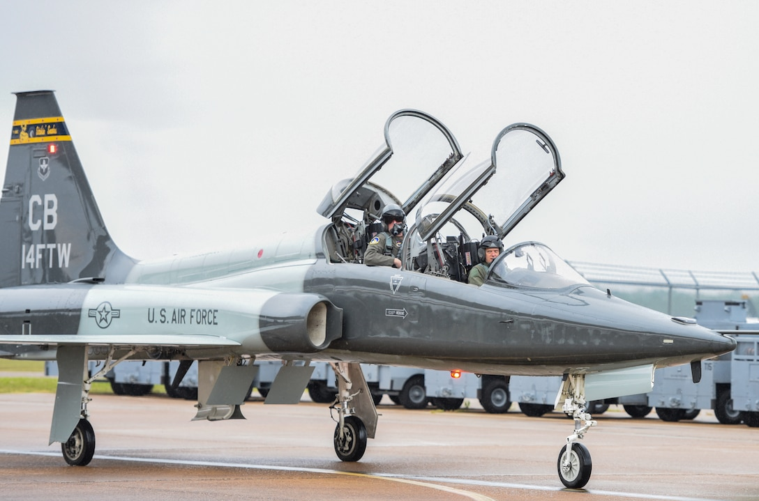 U.S. Air Force Lt. Col. David Easterling Jr., 43rd Flying Training Squadron instructor pilot, and Capt. Kevin Mudd, 50th FTS instructor pilot, taxi on the flightline after his flight on September 23, 2020, at Columbus Air Force Base, Miss. The T-38 first flew in 1959 and the Air and Education Command began receiving T-38 models in 2001. (U.S. Air Force photo by Airman 1st Class Davis Donaldson)