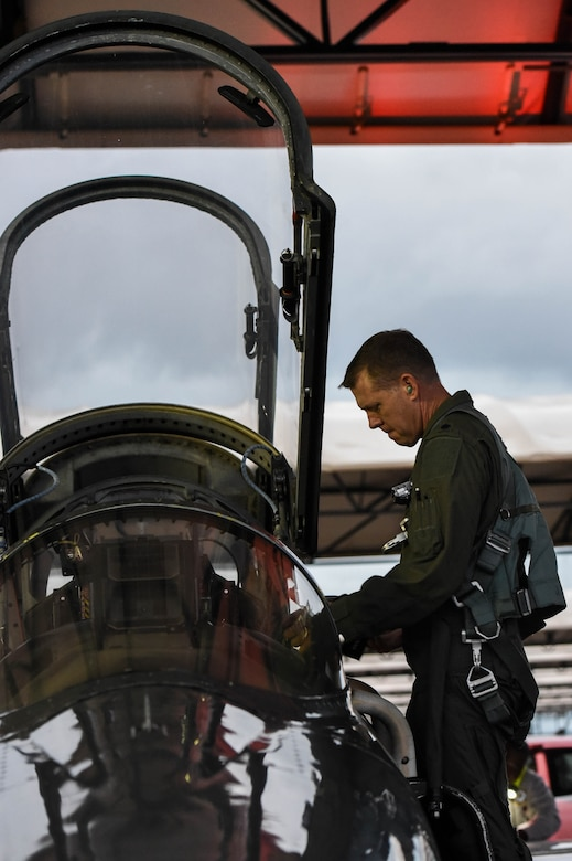 U.S. Air Force Lt. Col. David Easterling Jr., 43rd Flying Training Squadron instructor pilot, prepares to enter the cockpit of a T-38 Talon on September 23, 2020, at Columbus Air Force Base, Miss. The T-38 has swept wings, a streamlined fuselage and tricycle landing gear with a steerable nose wheel. (U.S. Air Force photo by Airman 1st Class Davis Donaldson)