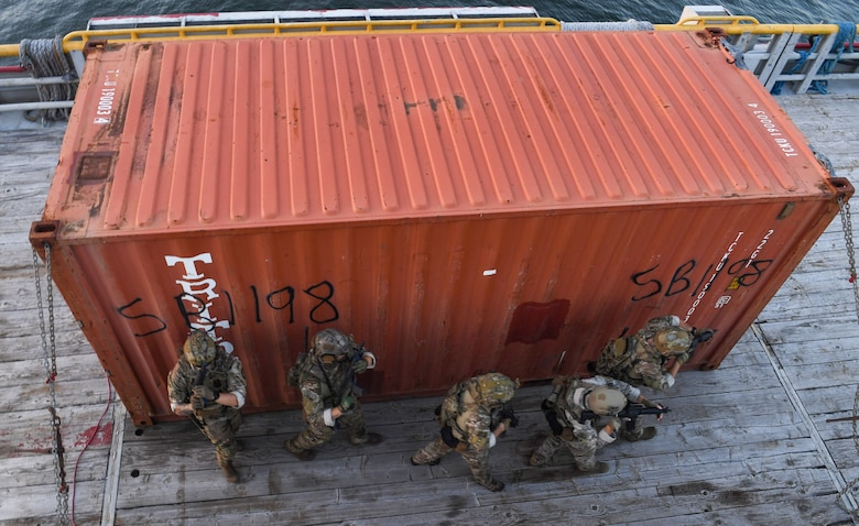 U.S. Coast Guardsmen from the Maritime Security Response Team East simulate interdicting a jammer on a vessel in support of Advanced Battle Management System Onramp 2 in the Gulf of Mexico, Sept. 2, 2020. ABMS is an interconnected battle network - the digital architecture or foundation - which collects, processes and shares data relevant to warfighters. In order to achieve all-domain superiority, it requires that individual military activities not simply be de-conflicted, but rather integrated – activities in one domain must enhance the effectiveness of those in another domain. (U.S. Air Force photo by Staff Sgt. Haley Phillips)
