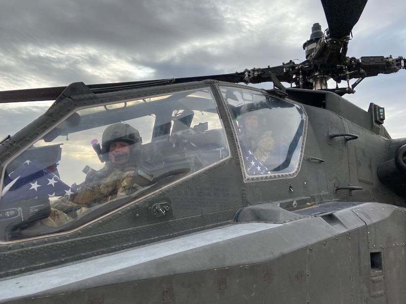 Chief Warrant Officer 4 Isaac Smith (front) and Chief Warrant Officer 4 Stewart Smith (rear) in an APH-64D Apache helicopter, Aug. 31, 2020, Mazar-i-Sharif, Afghanistan. (Courtesy photo by CW4 Isaac and Stewart Smith)
