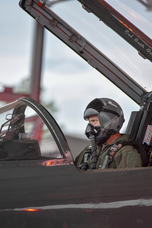 """U.S. Air Force Lt. Col. David Easterling Jr., 43rd Flying Training Squadron instructor pilot, goes through system checks in the cockpit of a T-38 Talon on September 23, 2020, at Columbus Air Force Base, Miss. The T-38 incorporates a """"glass cockpit"""" with integrated avionics displays, head-up display and an electronic """"no drop bomb"""" scoring system. (U.S. Air Force photo by Airman 1st Class Davis Donaldson)"""