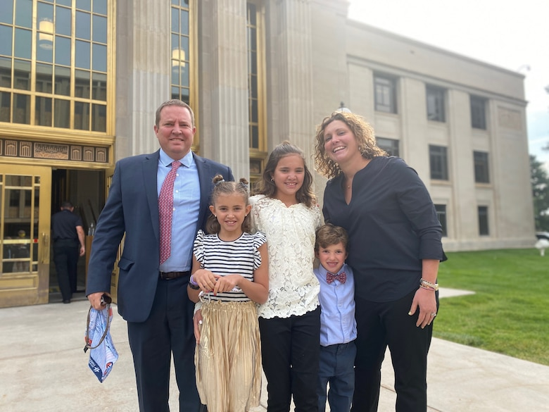Maj. Robert Sanford, who serves part time as the 419th Security Forces Squadron commander at Hill Air Force Base, Utah, poses with his family at his robing ceremony, where he was appointed as a circuit court judge in Laramie, Wyoming