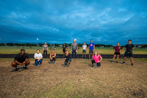 U.S. Air Force Chief Master Sgt. Wendell Snider (left), 502nd Air Base Wing and Joint Base San Antonio command chief, pose for a photo with participants after a three-mile run Sept. 22, 2020, at JBSA-Fort Sam Houston, Texas. Snider, along with JBSA teammates, used exercise to connect and decompress.
