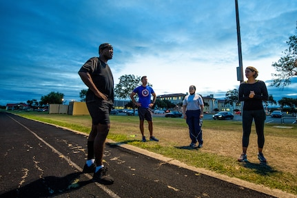 U.S. Air Force Chief Master Sgt. Wendell Snider (left), 502nd Air Base Wing and Joint Base San Antonio command chief, meets with participants for a three-mile run Sept. 22, 2020, at JBSA-Fort Sam Houston, Texas.