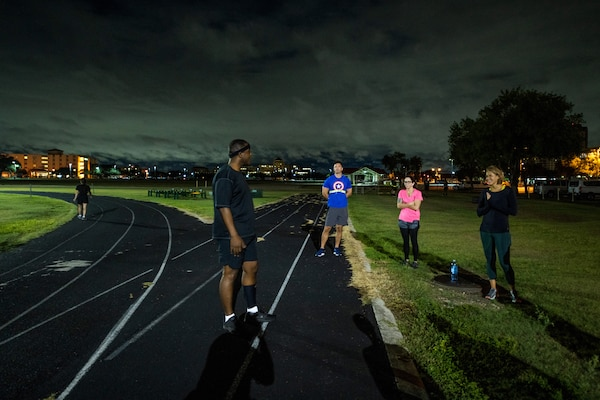 U.S. Air Force Chief Master Sgt. Wendell Snider, left, 502nd Air Base Wing and Joint Base San Antonio command chief, meets with participants for a three-mile run Sept. 22, 2020, at JBSA-Fort Sam Houston, Texas. Snider, along with JBSA teammates, used exercise to connect and decompress.