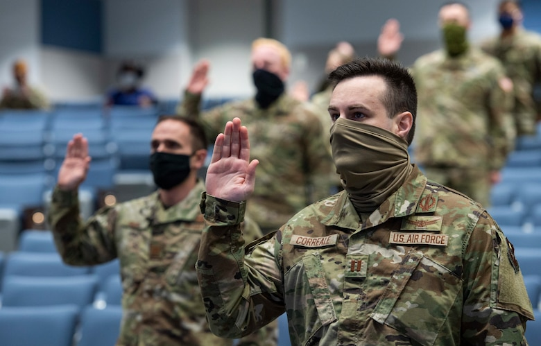 """Capt. Anthony Correal, an operations research master's student at the Air Force Institute of Technology is sworn into the U.S. Space Force during a virtual commissioning and enlistment ceremony led by U.S. Space Force Chief of Space Operations Gen. John W. """"Jay"""" Raymond on Sept. 15, 2020.  (U.S. Air Force photo/Wesley Farnsworth)"""