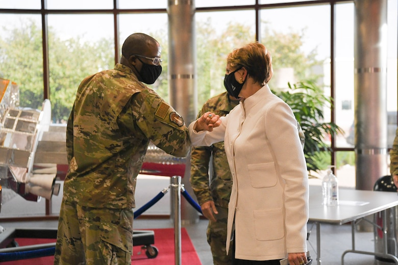 Chief Master Sgt. Willie Frazier II, Space Delta 4 senior enlisted leader, greets Secretary of the Air Force Barbara Barrett, Sept. 23, 2020 at DEL 4's Mission Control Station on Buckley Air Force Base, Colo.