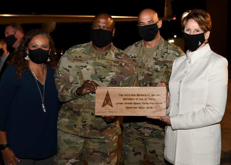 Secretary of the Air Force Barbara Barrett is presented with a plaque from Buckley Garrison command team prior to her departure from Buckley Air Force Base, Colo., on Sept. 23, 2020.