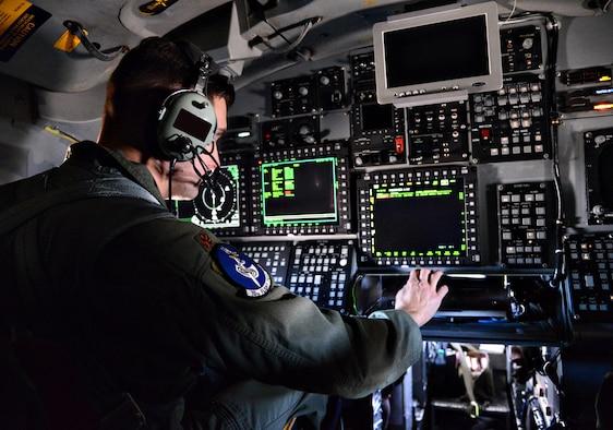 Airman sitting at station aboard B-1