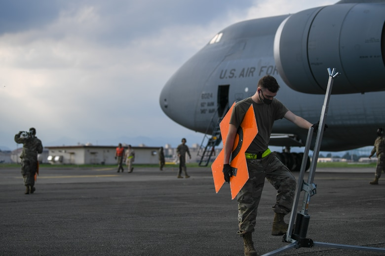 Special handling technician marks a C-5M Supergalaxy for explosives
