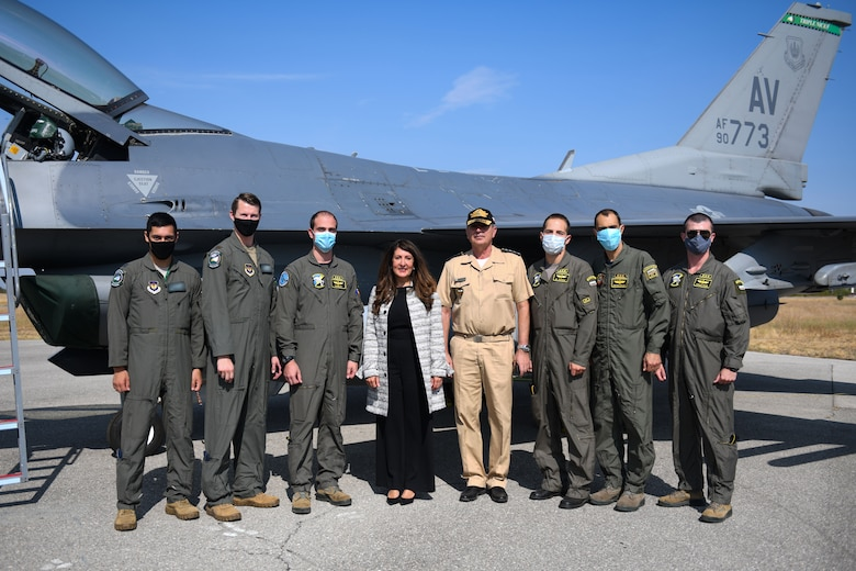 Herro Mustaf, U.S. Ambassador to the Republic of Bulgaria, left center, and Admiral Eftimov, Bulgarian chief of defense, right center, pose with the U.S. Air Force and Bulgarian air force pilots for a photo in front of a U.S. Air Force F-16 Fighting Falcon during Thracian Viper 20 at Graf Ignatievo Air Base, Bulgaria, Sept. 24, 2020. Thracian Viper 20 is a multilateral training exercise with the Bulgarian air force, aimed to increase operational capacity, capability and interoperability with Bulgaria. (U.S. Air Force photo by Airman 1st Class Ericka A. Woolever)