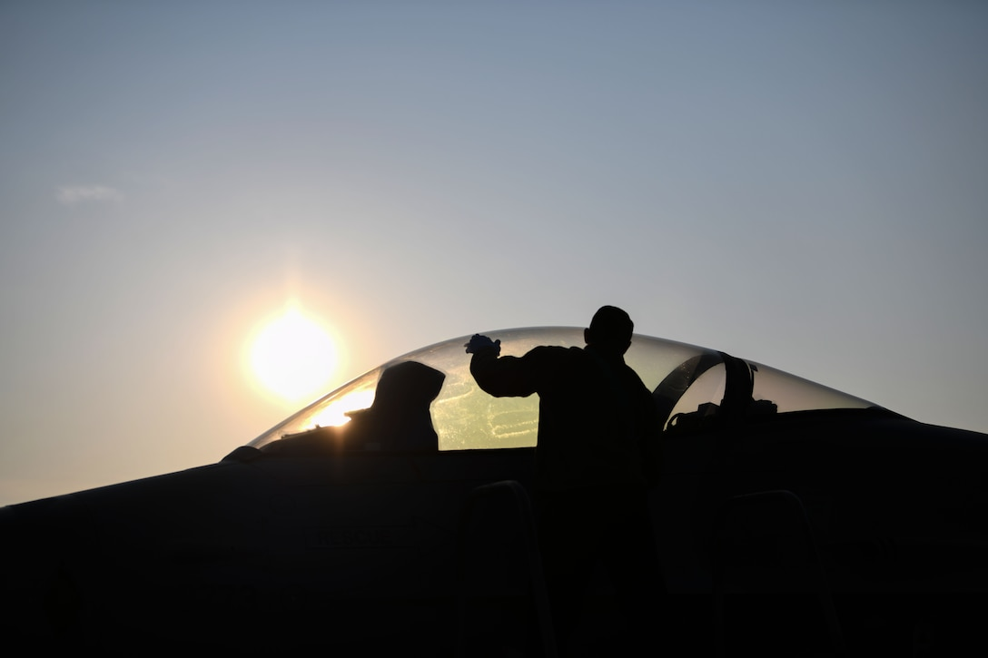 U.S. Air Force Staff Sgt. Travis Martinez, 31st Aircraft Maintenance Squadron dedicated crew chief, cleans a forward transparency window during exercise Thracian Viper 20, Sept. 24, 2020, at Graf Ignatievo Air Base, Bulgaria. The 31st AMXS planned and directed expeditionary aircraft generation and maintenance operations. During exercise Thracian Viper 20, crew chiefs performed walk around inspections of the U.S. Air Force F-16 Fighting Falcon. (U.S. Air Force photo by Airman 1st Class Ericka A. Woolever)