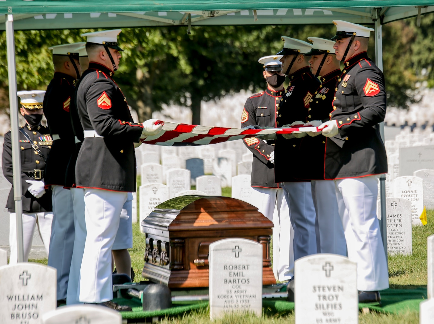 Marine Corps Body Bearers, Bravo Company, Marine Barracks Washington, D.C., prepare to fold the National Ensign during a full honors funeral for repatriated WWII Marine Pfc. Harry Morrissey at Arlington National Cemetery, Arlington, Virginia, Sept. 22, 2020.