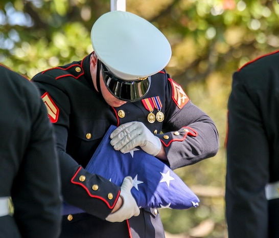 A Marine Corps Body Bearer, Bravo Company, Marine Barracks Washington, D.C., folds the National Ensign during a full honors funeral for repatriated WWII Marine Pfc. Harry Morrissey at Arlington National Cemetery, Arlington, Virginia, Sept. 22, 2020.