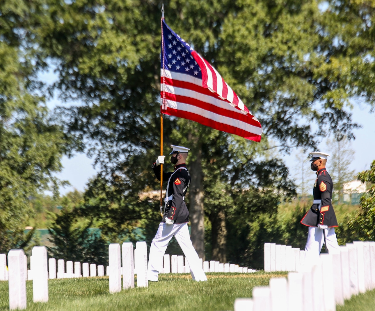Lance Cpl. Joshua Murphy, flag bearer, the Official U.S. Marine Corps Color Guard, marches with the National Ensign during a full honors funeral for repatriated WWII Marine Pfc. Harry Morrissey at Arlington National Cemetery, Arlington, Virginia, Sept. 22, 2020.