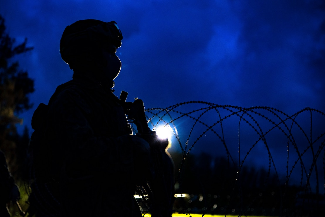 A Marine stands watch during a simulated embassy reinforcement at Kin Blue, Okinawa, Japan, Sept. 13.