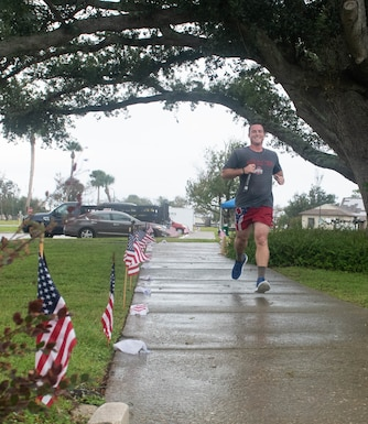 A volunteer runner participates in a 24-hour vigil run at Tyndall Air Force Base, Sept. 24, 2020. The event was held to honor POW/MIA for the 32nd consecutive year at Tyndall. (U.S. Air Force photo by Airman Anabel Del Valle)