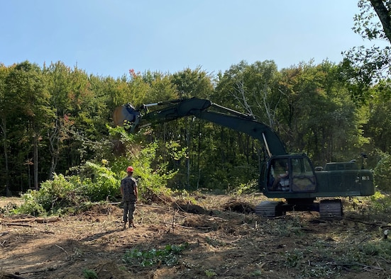 U.S. Marines from Marine Wing Support Squadron 472, Detachment B use an excavator to remove trees and brush during renovations to the explosive ordinance disposal range Sept. 21, 2020 on Westover Air Reserve Base, Massachusetts. Improvements to the EOD range include a new road and reinforced connex viewing bunker. (U.S. Air Force photo by Maj. Meghan Smith)