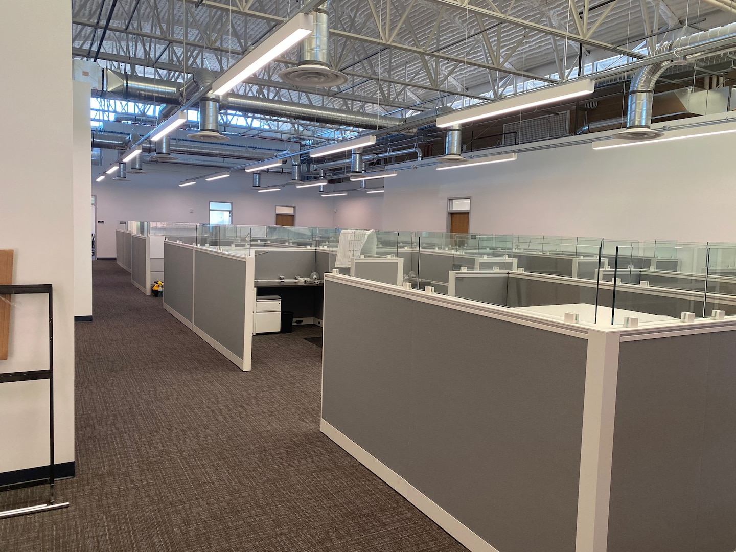Renovated office space with new cubicles pictured.