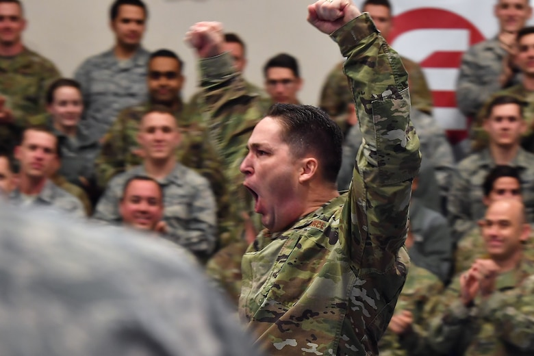 Then Senior Master Sgt. Michael Rozneck, 50th Operations Support Squadron superintendent, learns he earned the rank of chief master sergeant March 4, 2020, at Schriever Air Force Base, Colorado. Rozneck battled and beat stage two testicular cancer after undergoing emergency surgery and 23 rounds of chemo therapy. Through it all, he said he learned to appreciate the present and stop worrying about the past and future. (U.S. Air Force photo by Dennis Rogers)
