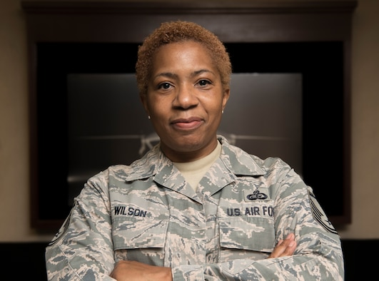 A female Airman smiles at the camera