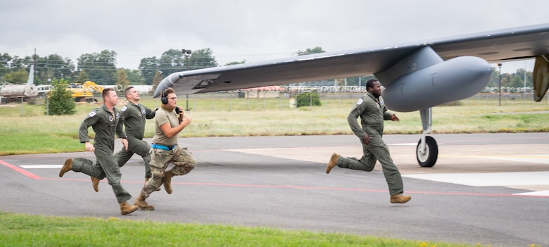 Barksdale Airmen run to a B-52H Stratofortress during a readiness exercise at Barksdale Air Force Base, La., Sept. 25, 2020.