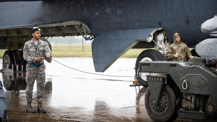 Senior Airman Timothy Pierce and Senior Airman Paul Donahue, 20th Aircraft Maintenance Unit weapons load crew members, load munitions on a B-52H Stratofortress during a readiness exercise at Barksdale Air Force Base, La., Sept. 21, 2020.
