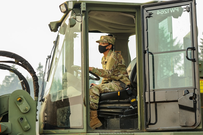 U.S. Air Force Senior Airman Jamie Boyd, a pest management apprentice assigned to the 446th Civil Engineer Squadron (CE), trains on the 10K All-Terrain Forklift on Sept. 11, 2020 at Joint Base Lewis-McChord, Washington.