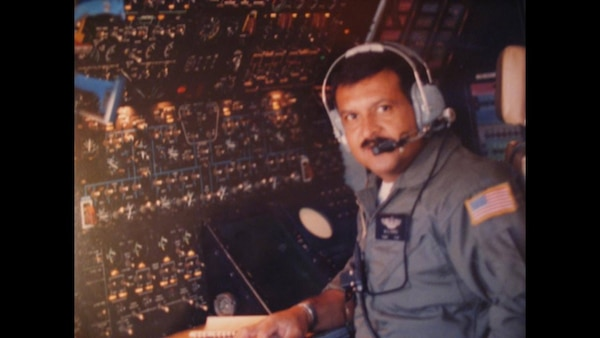 Tech. Sgt. Daniel Perez, 68th Airlift Squadron loadmaster, takes a moment while working. Perez passed away in a C-5A Galaxy crash at Ramstein Air Base, Germany, Aug. 29, 1990, in support of Operation Desert Shield. (Courtesy photo)