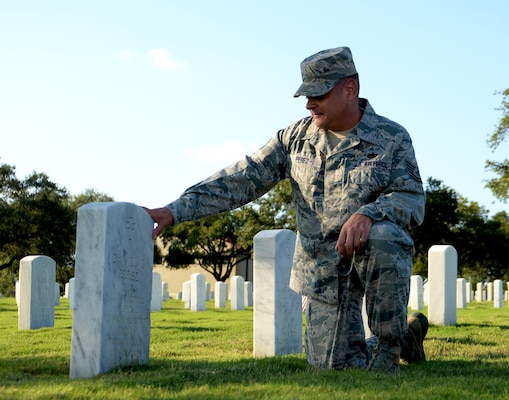 Tech. Sgt. Joseph Perez, 26th Aerial Port Squadron ramp services supervisor, visits the grave of his father Sept. 25, 2020, at Fort Sam Houston Cemetery, San Antonio, Texas. (U.S. Air Force photo by Tech. Sgt. Samantha Mathison)