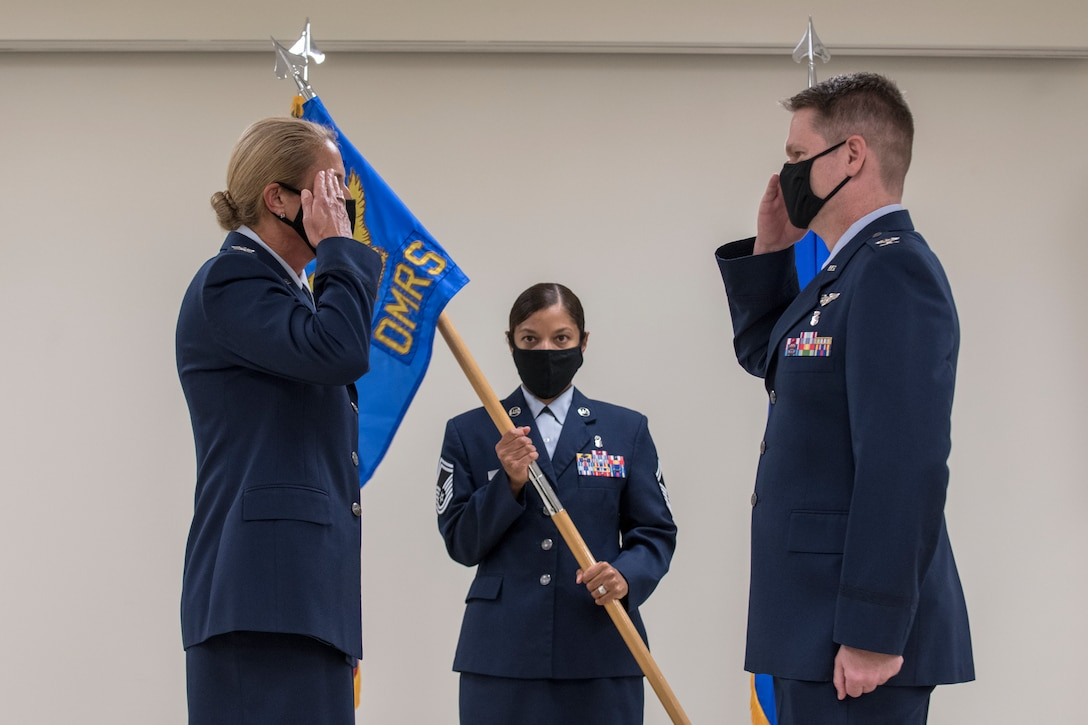 Airmen salute each other