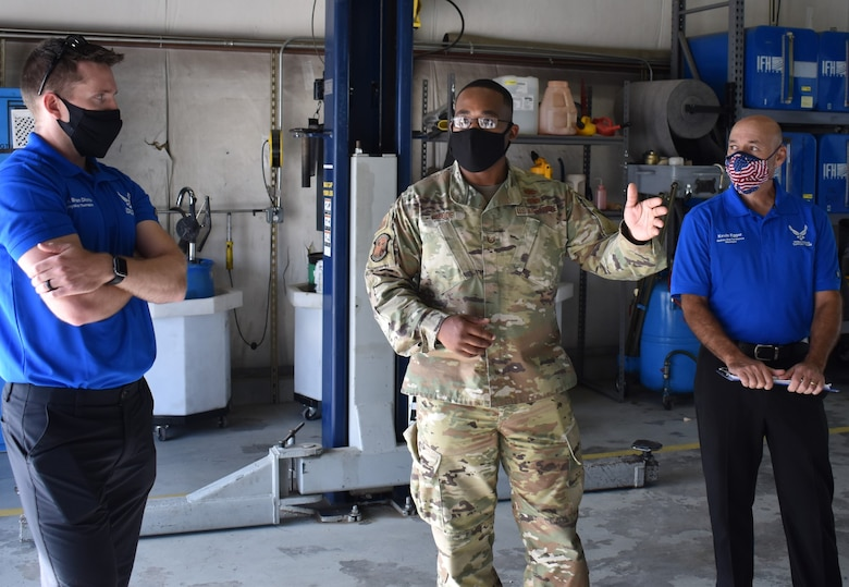 Tech. Sgt. Jamal Goode, 75th Logistics Readiness Squadron, gives a tour of Vehicle Maintenance, to members of the Operational Support Team, Kevin Egger (right) and Brian Diiorio.