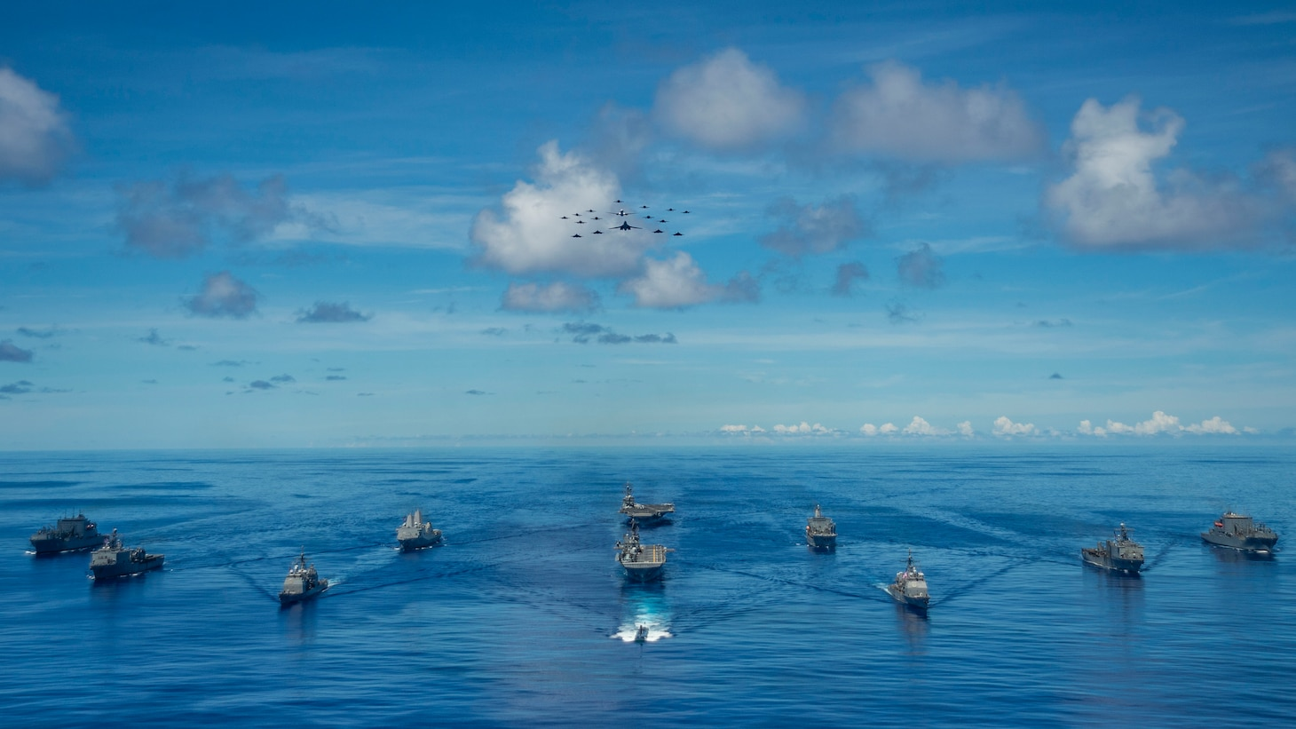 PHILIPPINE SEA (Sept. 25, 2020) From left, USNS Charles Drew (T-AKE 10), USS Comstock (LSD 45), USS Shiloh (CG 67), USS New Orleans (LPD 18), USS Chicago (SSN 721), USS America (LHA 6), USS Ronald Reagan (CVN 76), USNS John Ericsson (T-AO 194), USS Antietam (CG 54), USS Germantown (LSD 42), and USNS Sacagawea (T-AKE 2) steam in formation in support of Valiant Shield 2020. Valiant Shield is a U.S. only, biennial field training exercise (FTX) with a focus on integration of joint training in a blue-water environment among U.S. forces. This training enables real-world proficiency in sustaining joint forces through detecting, locating, tracking and engaging units at sea, in the air, on land and in cyberspace in response to a range of mission areas. (U.S. Navy photo by Mass Communication Specialist 2nd Class Codie Soule)