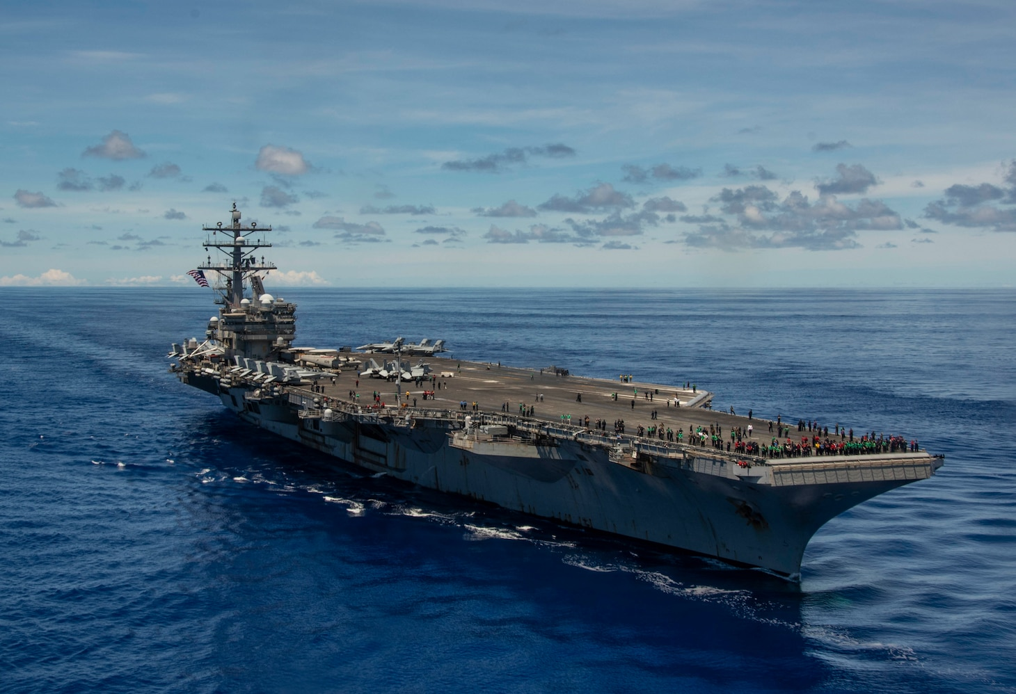 PHILIPPINE SEA (Sept. 25, 2020) The Navy's only forward-deployed aircraft carrier USS Ronald Reagan (CVN 76) steams in formation in support of Valiant Shield 2020. Valiant Shield is a U.S. only, biennial field training exercise (FTX) with a focus on integration of joint training in a blue-water environment among U.S. forces. This training enables real-world proficiency in sustaining joint forces through detecting, locating, tracking and engaging units at sea, in the air, on land and in cyberspace in response to a range of mission areas. (U.S. Navy video by Mass Communication Specialist 2nd Class Codie Soule)