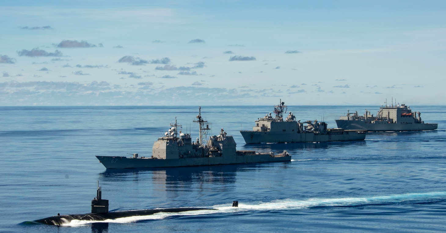 PHILIPPINE SEA (Sept. 25, 2020) USS Chicago (SSN 721), front, USS Shiloh (CG 67), USS Comstock (LSD 45), USNS Sacagawea (T-AKE 2) and USNS Charles Drew (T-AKE 10) steam in formation with the Navy's only forward-deployed aircraft carrier USS Ronald Reagan (CVN 76), in support of Valiant Shield 2020. Valiant Shield is a U.S. only, biennial field training exercise (FTX) with a focus on integration of joint training in a blue-water environment among U.S. forces. This training enables real-world proficiency in sustaining joint forces through detecting, locating, tracking and engaging units at sea, in the air, on land and in cyberspace in response to a range of mission areas. (U.S. Navy video by Mass Communication Specialist 2nd Class Erica Bechard)