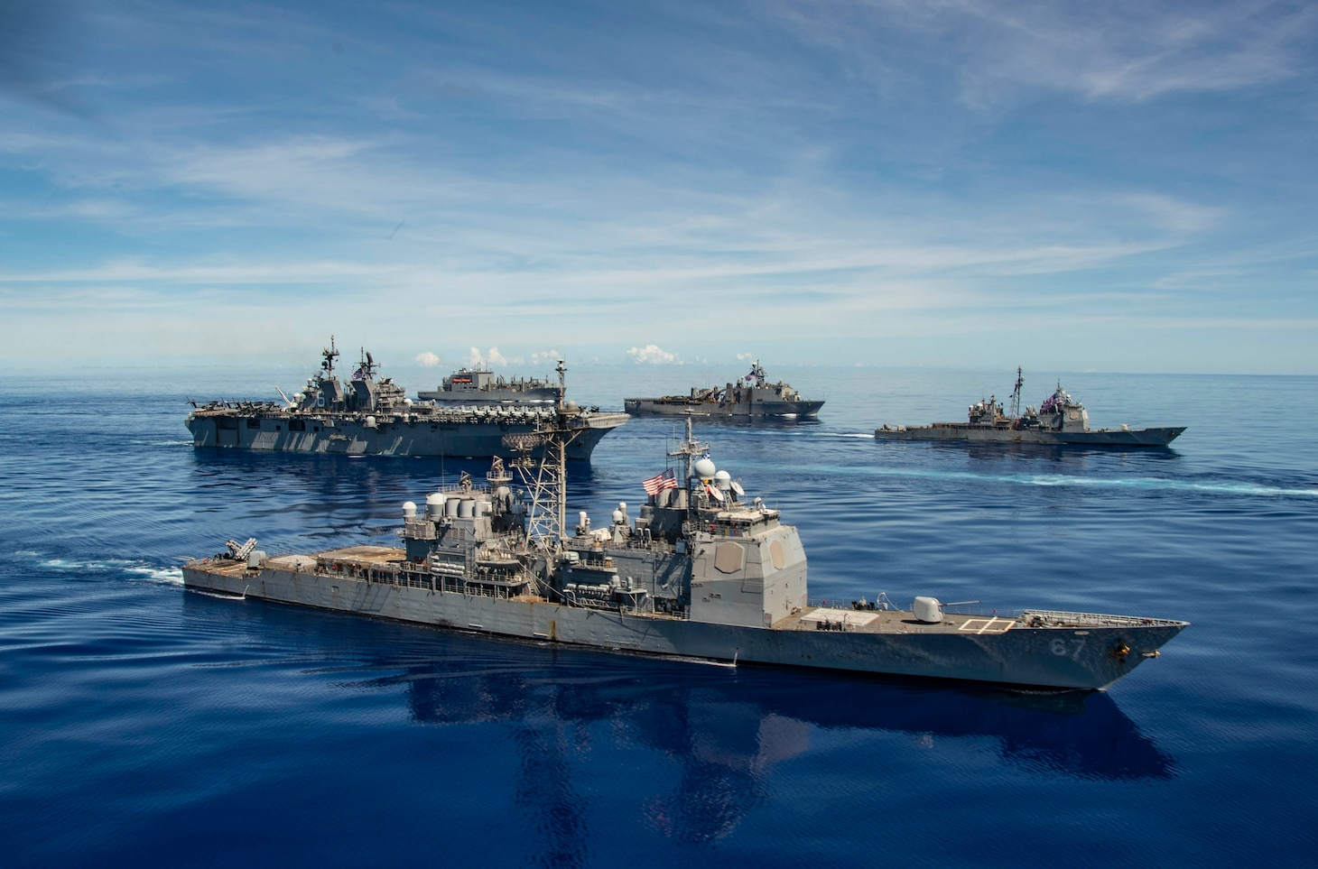 PHILIPPINE SEA (Sept. 25, 2020) USS Shiloh (CG 67), front, USS America (LHA 6), USS Antietam (CG 54), USS Germantown (LSD 42) and USNS Sacagawea (T-AKE 2), steam in formation with the Navy's only forward-deployed aircraft carrier USS Ronald Reagan (CVN 76), in support of Valiant Shield 2020. Valiant Shield is a U.S. only, biennial field training exercise (FTX) with a focus on integration of joint training in a blue-water environment among U.S. forces. This training enables real-world proficiency in sustaining joint forces through detecting, locating, tracking and engaging units at sea, in the air, on land and in cyberspace in response to a range of mission areas. (U.S. Navy video by Mass Communication Specialist 2nd Class Erica Bechard)