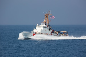 The Coast Guard patrol boat USCGC Wrangell (WPB 1332), attached to Task Force (TF) 55, participates in the joint air operations in support of maritime surface warfare (AOMSW) exercise in the Arabian Gulf, Sept. 23. Combined integration operations between joint U.S. forces are regularly held to maintain interoperability and the capability to counter threats posed in the maritime domain, ensuring freedom of navigation and free flow of commerce throughout the region's heavily trafficked waterways. (U.S. Army photo by Spc. Joshua DuRant)