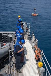 Sailors assigned to the Navy coastal patrol ship USS Whirlwind (PC 11) set up a target for an aerial gunnery drill during the joint air operations in support of maritime surface warfare (AOMSW) exercise in the Arabian Gulf, Sept. 24. Combined integration operations between joint U.S. forces are regularly held to maintain interoperability and the capability to counter threats posed in the maritime domain, ensuring freedom of navigation and free flow of commerce throughout the region's heavily trafficked waterways.