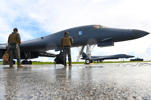 Aircrew assigned to the 34th Expeditionary Bomb Squadron, Ellsworth Air Force Base, S.D., prepare to board a B-1B Lancer in support of Exercise Valiant Shield at Andersen AFB, Guam, Sept. 18, 2020. The participating forces will exercise a wide range of capabilities and demonstrate the inherent flexibility of joint forces. The range of capabilities include maritime security operations, anti-submarine and air-defense exercises, amphibious operations, and other elements in complex warfighting. (U.S. Air Force photo by Staff Sgt. Nicolas Z. Erwin)